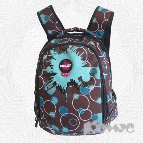Рюкзак украшен принтами в виде голубых кругов, изготовлен из...